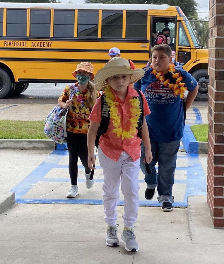 Students dressed up as tourists enter school Tuesday morning.