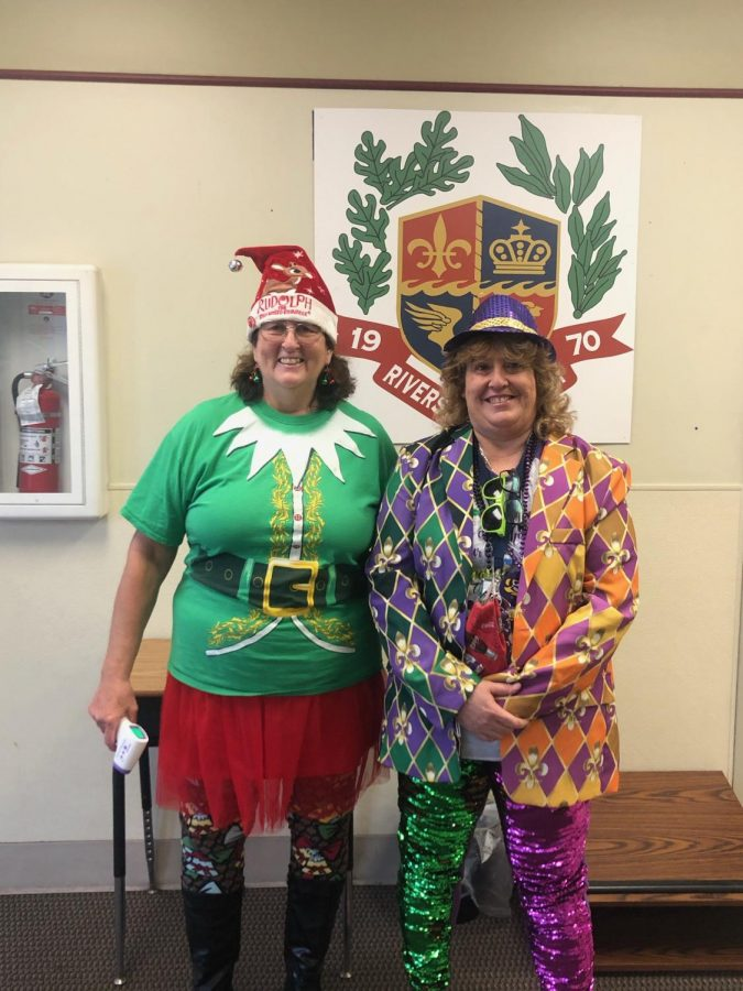 Ms. Villere, who dressed as a Christmas elf, posed with Ms. Delauneville.