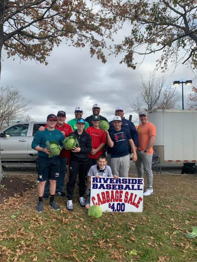 Members of the Rebels baseball team and their dads worked the LaPlace location.