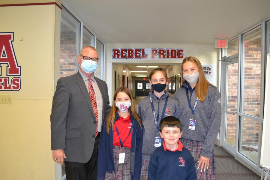 Students of the week for the week of January 4 pose with principal Mike Coburn.