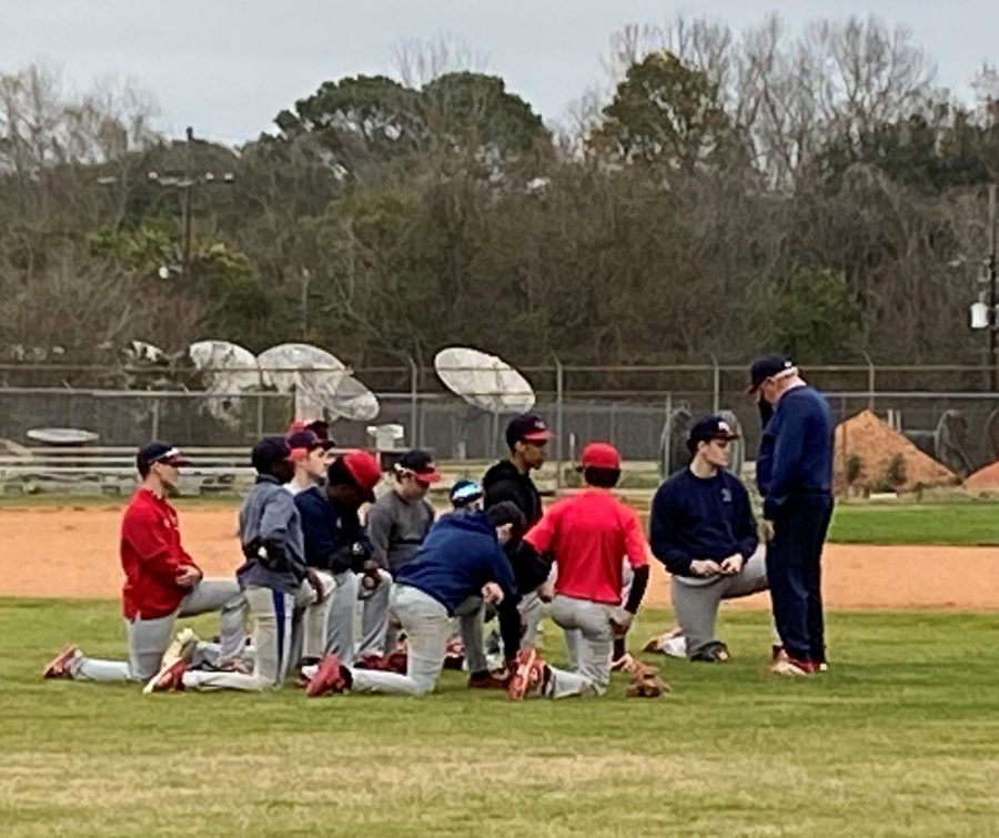 Coach+Marty+Luquet+speaks+to+the+Rebel+baseball+team+after+practice