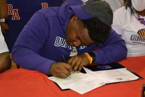 Defensive lineman Nick Washington signed with Ouachita Baptist University