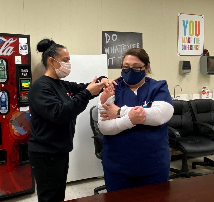Ms. Jung receives the Covid-19 vaccine from a nurse from The Urgent Care Clinic of LaPlace.