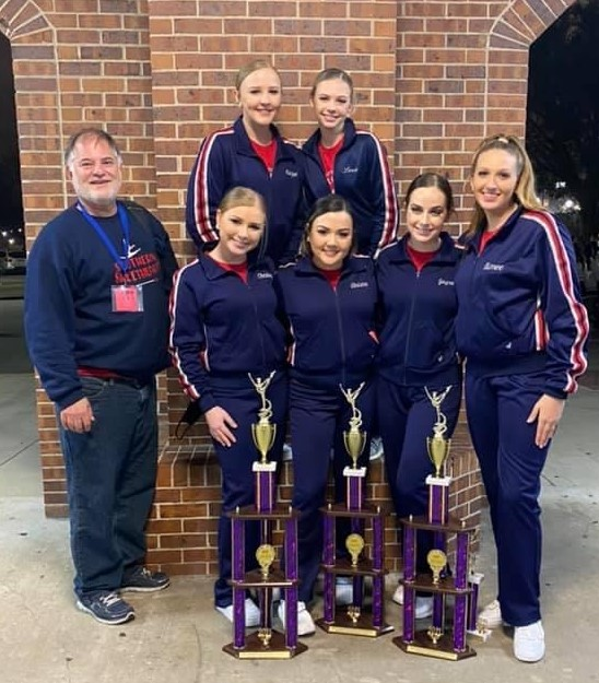The Southern Sweethearts, under the direction of Darryl Clement (left) include: Front row, from left, Christy Louque, Ariana Matt, Jaycee Bennett, Amiee Duhe. Back row, Kaylee Louque and Lexie Heltz.