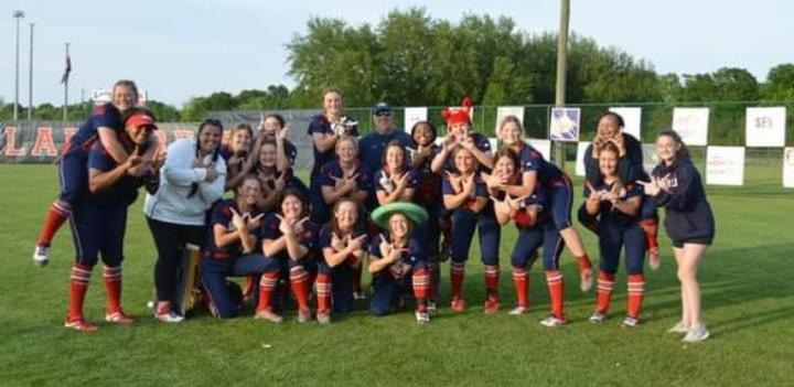 The Lady Rebels celebrated after Thursday's victory over St. John.