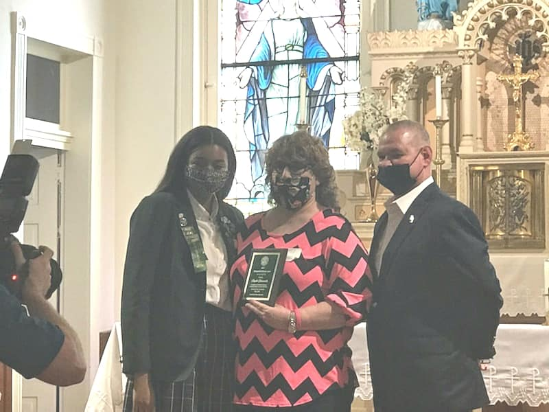 Cabrini junior Kamryn Scales, Riverside teacher Angelle DeLaneuville and Riverside principal Mike Coburn attend the Distinguished Educator Award ceremony at Cabrini May 4, 2021