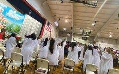 The graduates of 2021 toss their mortar boards into the air after receiving their diplomas on May 19.