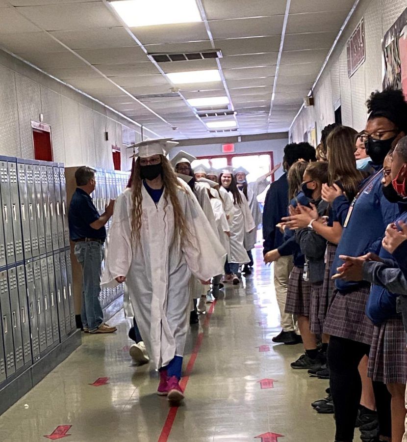 The seniors take their traditional final walk through the halls on their last full day of school.