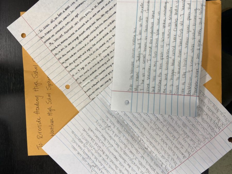 Students at Westlake High School wrote letters to Riverside Academy students, sharing their own hurricane experiences.